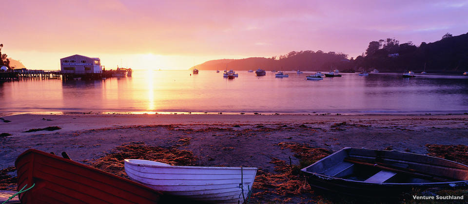 The quiet beach of Halfmoon Bay and watch the sun come up at one of New Zealand's most s