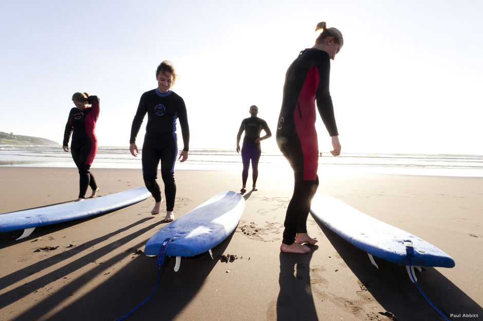 New Zealand's accredited surfing schools have refined the art of teaching people how to surf.