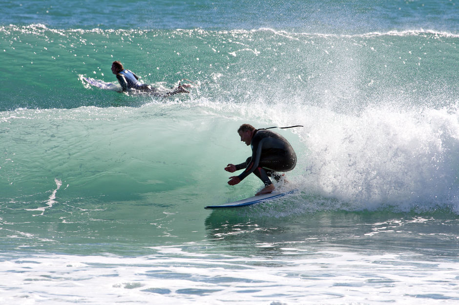 Surfing at Back Beach, New Plymouth.