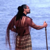 A Maori warrior surveys the oceans near Ngāmotu (New Plymouth). Māori oral history tells of vast ocean voyagers across the Pacific.