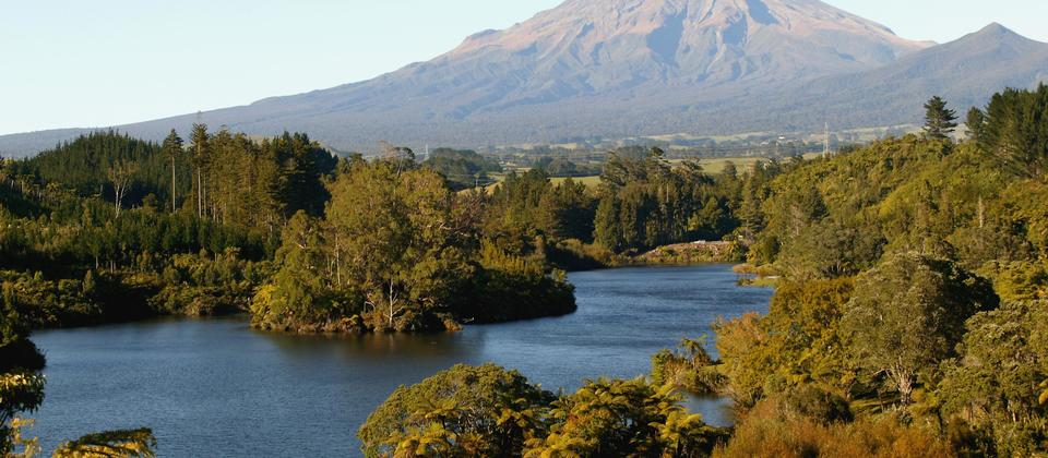 Mount Taranaki peaks up over Lake Mangamahoe. Located just 5 minutes drive from New Plymouth