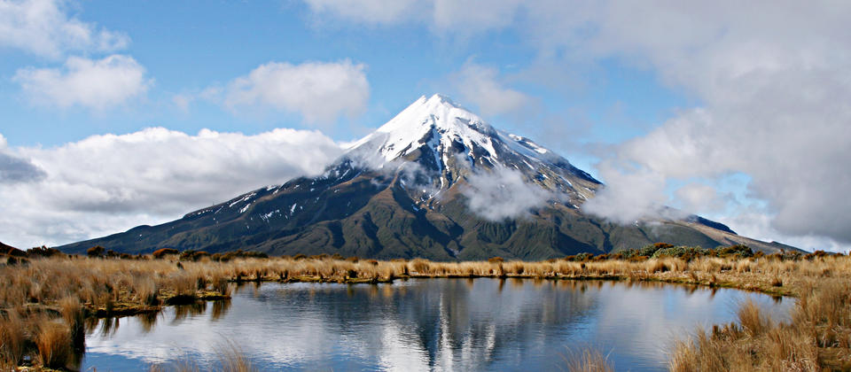 Get perfect views of Mount Taranaki during rewarding hike of the Pouakai Circuit in the northern region of Egmont National Park.