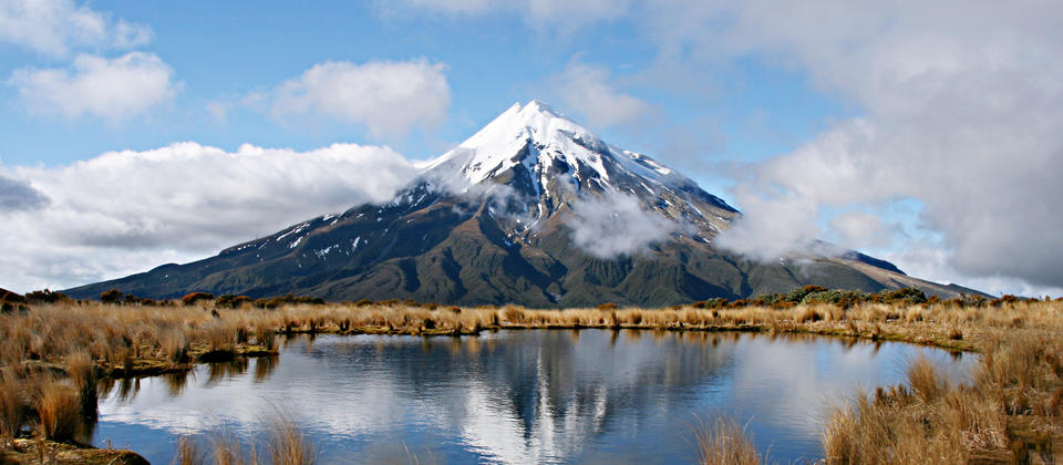 Mt Taranaki dominates the surrounding landscapes.