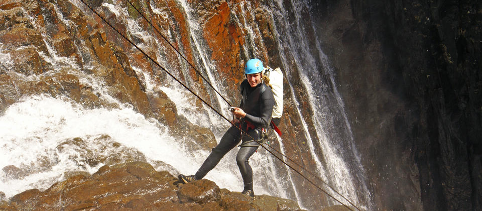 Abseiling into the Sleeping God Canyon with a guide from Canyonz