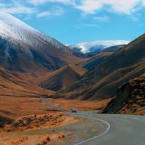 The Lindis Pass is memorable for its triangular hills clad in tussock grass.