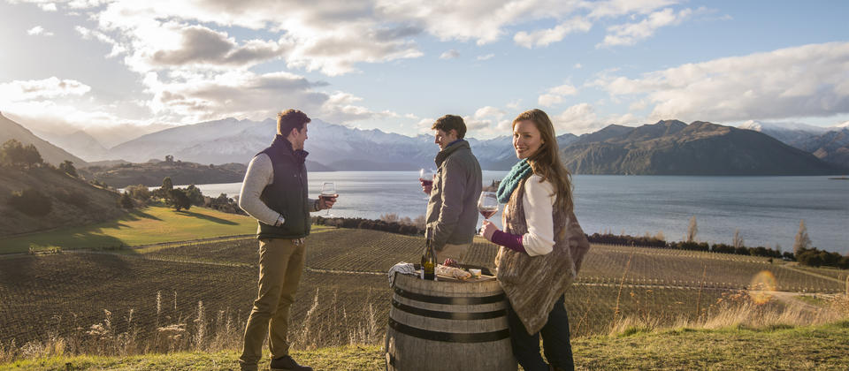Sampling an artisan pinot noir while you absorb the immense alpine scenery is one of the many joys you can experience in Wanaka.