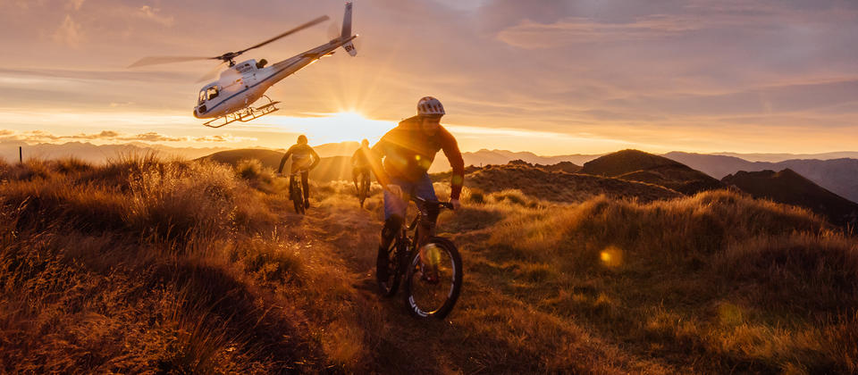 The ultimate Mount Burke mountain bike experience starts with a jaw-dropping helicopter ride high over Lake Wanaka and its surrounding mountains.