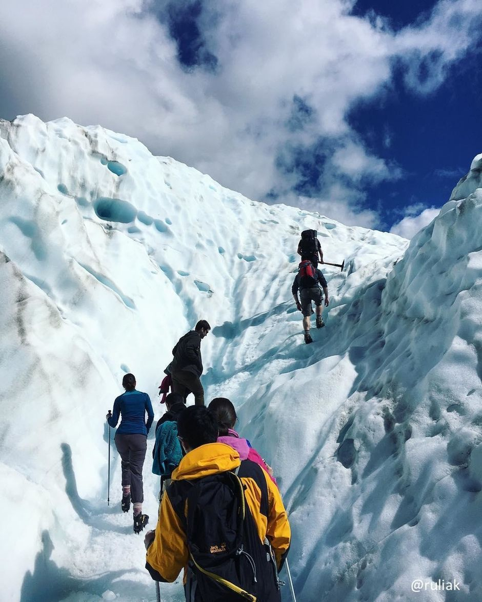 Hiking the stunning blue ice on Fox Glacier on the West Coast of New Zealand.