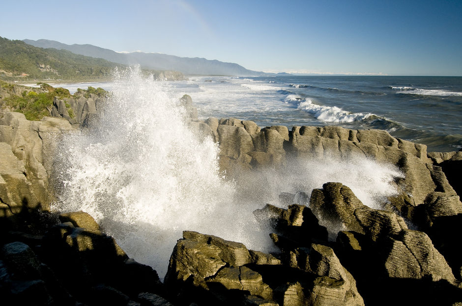 Ocean spray splashing up through Punakaiki's pancake rocks