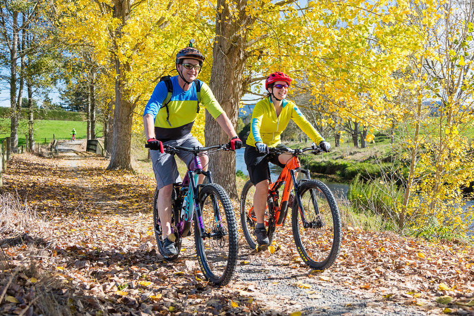 Couple cycling in Autumn, Hauraki Rail Trail,